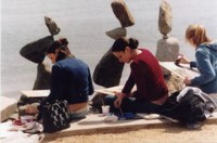 Girls drawing balanced stones